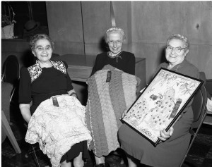 Golden Age Club 1951 Winners of the hobby show. L. to r.: Mrs. Erlen for crocheted tablecloth, Mrs. Ringer for knitted afghan, Mrs. Pler in the embroidery group for a peacock picture. Photo by Herb Topy.