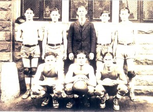 YMHA Basketball team at Schonthal Front row center: Mose Solomon. Rear row: Joe Bonowitz, coach; Lou Soppel, far right.